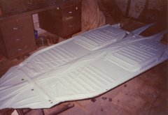 Painting the underside of the 1972 VW Beetle chassis.