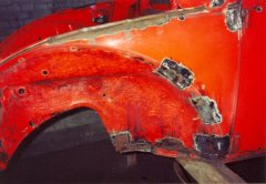 Repairing the front-left quarter on the 1972 VW Beetle.