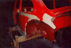 Repairing the rear-left quarter on the 1972 VW Beetle.